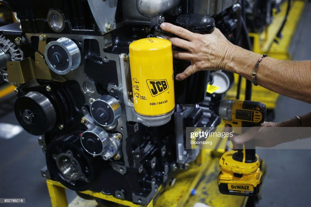 A factory worker assembles the engine of a construction vehicle at the JC Bamford Excavators LTD. (JCB) manufacturing plant in Pooler, Georgia, U.S., on Friday, Aug. 11, 2017. The Federal Reserve is scheduled to release industrial production figures on August 17. Photographer: Luke Sharrett/Bloomberg via Getty Images