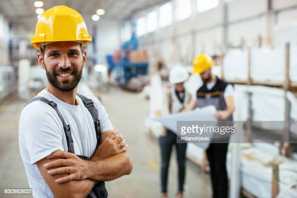 Factory worker controlling production
