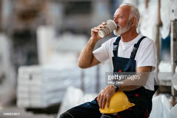 factory worker having coffee break - resting stock pictures, royalty-free photos & images