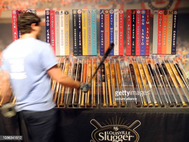 A factory worker holding a professional baseball bat at the Louisville Slugger factory in Louisville US 12 July 2016 18 million baseball bats are...