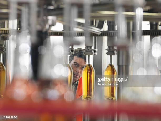 Factory worker in bottling plant