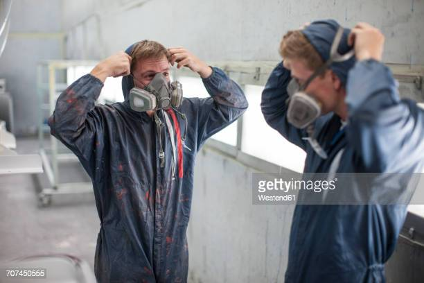 factory worker in truck manufacture adjusting respirators - gas mask stock pictures, royalty-free photos & images