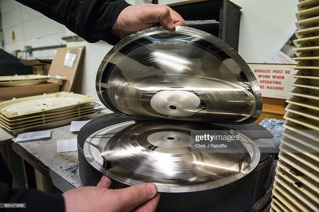 Factory worker Martin Frings peels apart a finished master and positive copy of a vinyl record before being copied and going to press at The Vinyl Factory on January 11, 2017 in Hayes, England. The Vinyl Factory is the largest vinyl pressing plant in the United Kingdom and produces up to 1.4 million records a year. The factory was founded in 2001 and has seen a 20% increase in sales and production year on year with clients including Warner Music, Universal Music, Bjork's label and their own label. Sales of vinyl records reached a 25 year high in 2016 when more than 3.2 million LPs were sold, a rise of 53% on the previous year.
