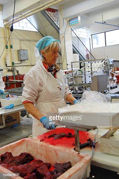 DESHAYES A factory worker packages whale meat on the islet of Skrova near Svolvaer on August 20 2008 In the Lofoten archipelago the centre of the...