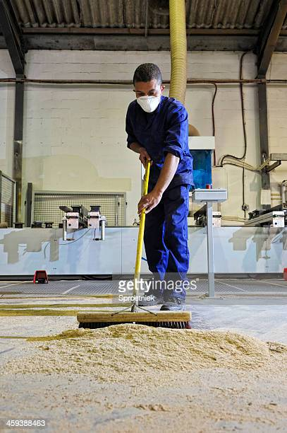 factory worker sweeping portrait - sweeping stock pictures, royalty-free photos & images