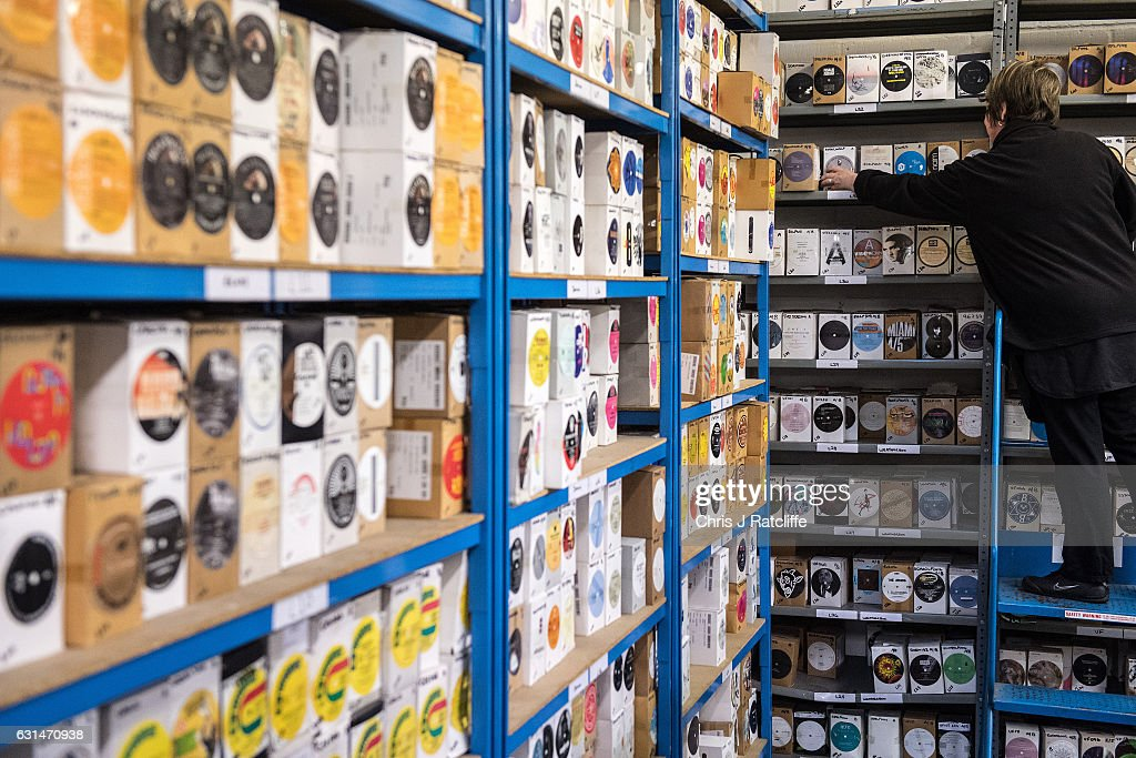 A factory worker takes a box of vinyl record labels from a shelf ready to be passed on to the pressing production at The Vinyl Factory on January 11, 2017 in Hayes, England. The Vinyl Factory is the largest vinyl pressing plant in the United Kingdom and produces up to 1.4 million records a year. The factory was founded in 2001 and has seen a 20% increase in sales and production year on year with clients including Warner Music, Universal Music, Bjork's label and their own label. Sales of vinyl records reached a 25 year high in 2016 when more than 3.2 million LPs were sold, a rise of 53% on the previous year.