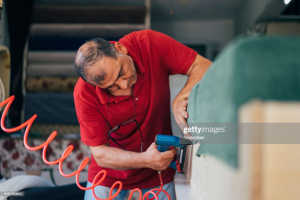 Factory Worker Upholstering Furniture Construction : Stock Photo