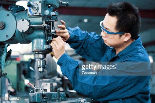 Asian Mechanic Worker Busy Working On Machine In Factory Stock Photo ...