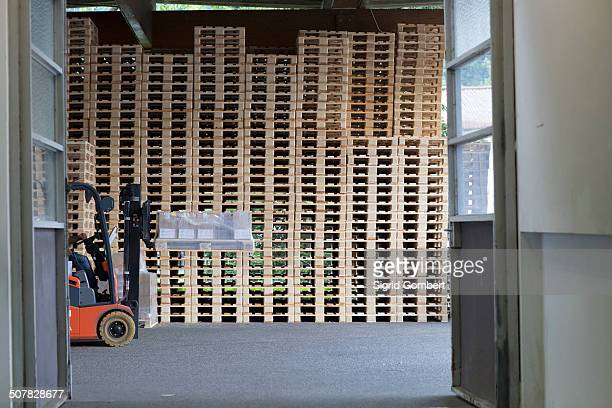factory worker using forklift truck - sigrid gombert stock pictures, royalty-free photos & images