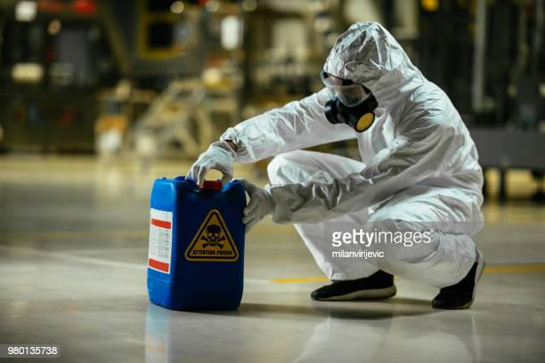 factory worker wearing gas mask and radioactive protection suit - explosive material stock photos and pictures