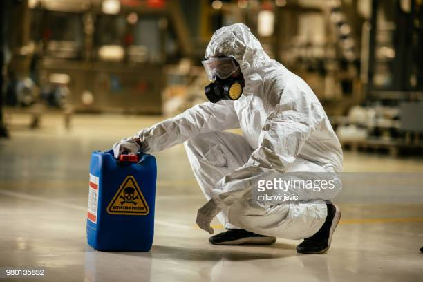 factory worker wearing radiation protection suit - hazmat stock pictures, royalty-free photos & images