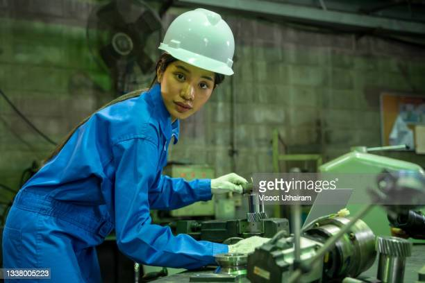 factory worker working and supervising production at small industrial plant. - workers compensation stock pictures, royalty-free photos & images