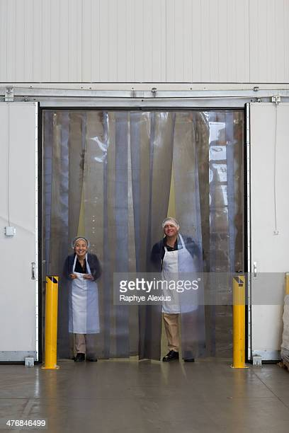 Factory workers by distribution warehouse loading bay