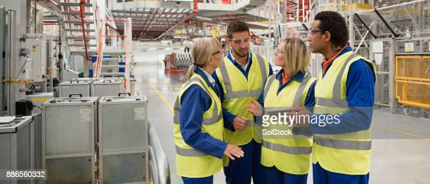 factory workers discussing - safety equipment stock pictures, royalty-free photos & images