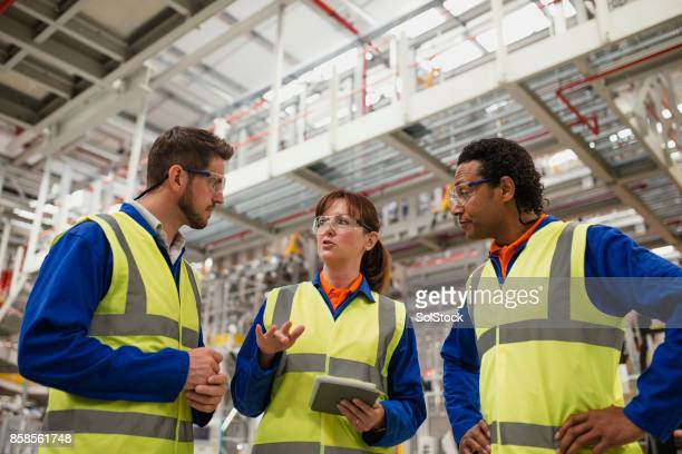 Factory Workers Having a Discussion