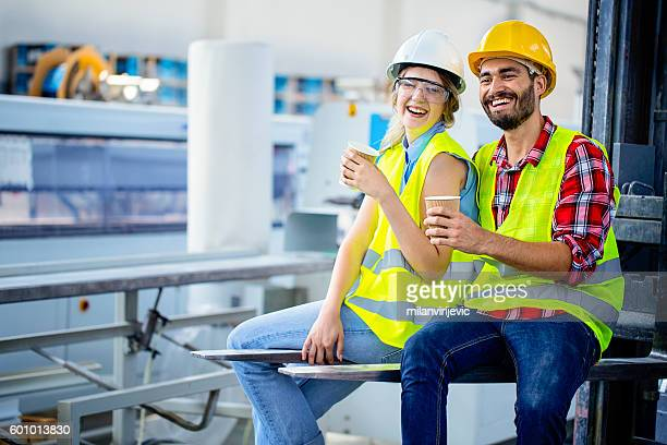 Factory workers on a coffee break