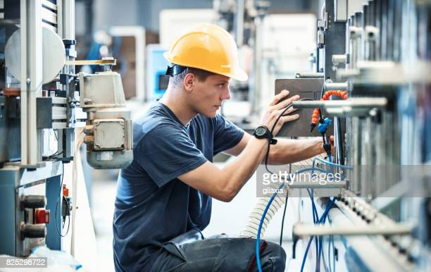 factory workers. - industry stock pictures, royalty-free photos & images
