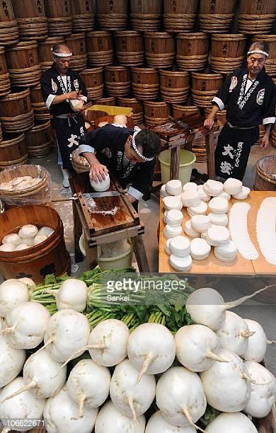 Factory workers produce pickled sliced radishes or Senmai Zuke at Daiyasu on November 7 2010 in Kyoto Japan