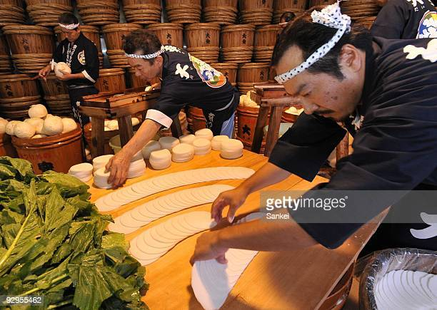 Factory workers produce pickled sliced radishes or Senmai Zuke at Daiyasu on November 7 2009 in Kyoto Japan