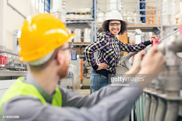 Factory workers talking and smiling