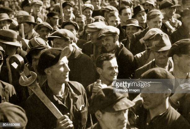 Factory workers with their tools celebrate the traditional Socialist holiday Germany 1936 May 1st the German Workers' National Holiday From Germany...
