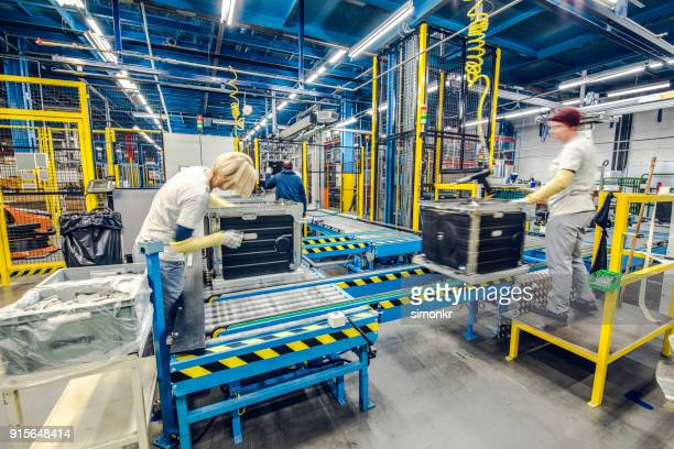 Factory workers working on production line