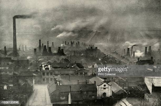 A Factoryscape in the Potteries' Smoke from chimneys in the industrial area known as the Staffordshire Potteries StokeonTrent Due to the local...