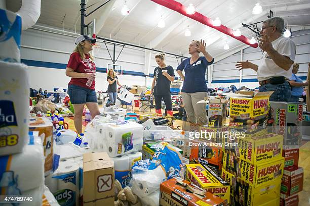 Faculty and volunteers organize flood relief supplies at Wimberley High School May 26, 2015 in Wimberley, Texas. Central Texas has been hit with...