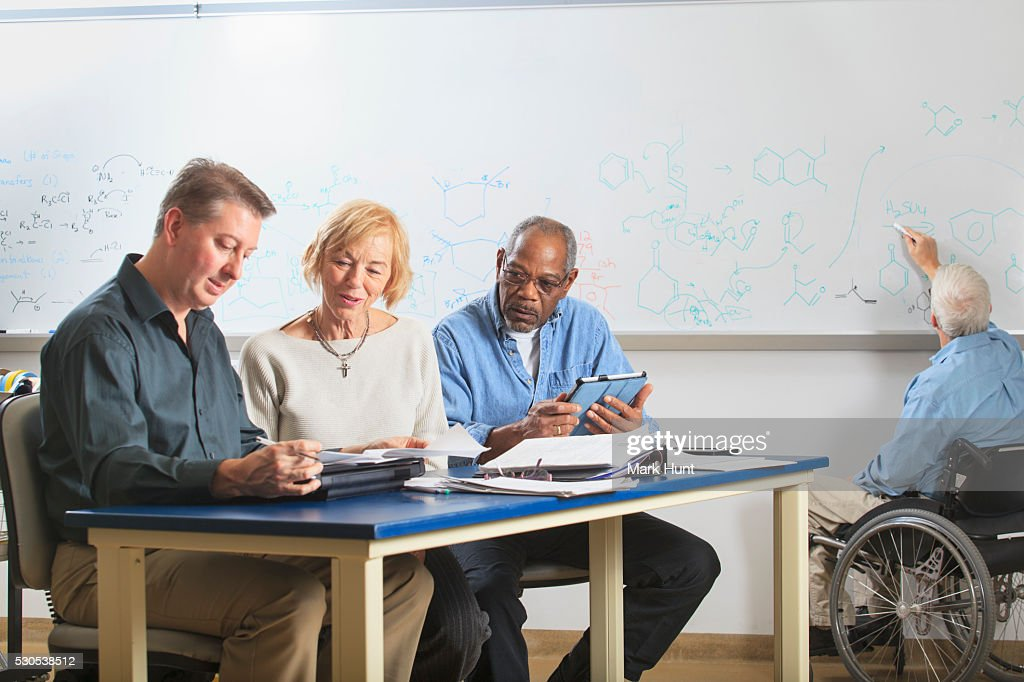 faculty meeting in an engineering school one professor with muscular