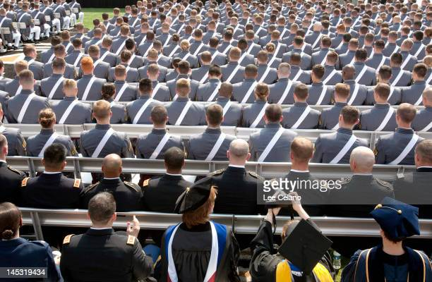 A faculty member of the The United States Military Academy takes a a photo of the graduation and commissioning ceremony May 26 2012 in West Point New...