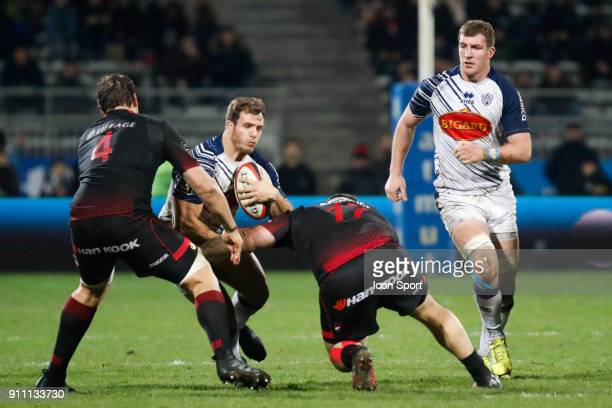 Facundo Bosch of Agen and Stéphane Clement of Lyon and Etienne Oosthuizen of Lyon during the Top 14 match between Lyon and Agen at Gerland Stadium on...