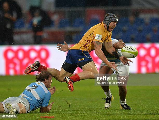 Facundo Bosch of Argentina Jaguars vies for the ball with Csaba Gal of Romania during 'World Rugby Nations Cup' in Bucharest on June 21 2015 Romania...