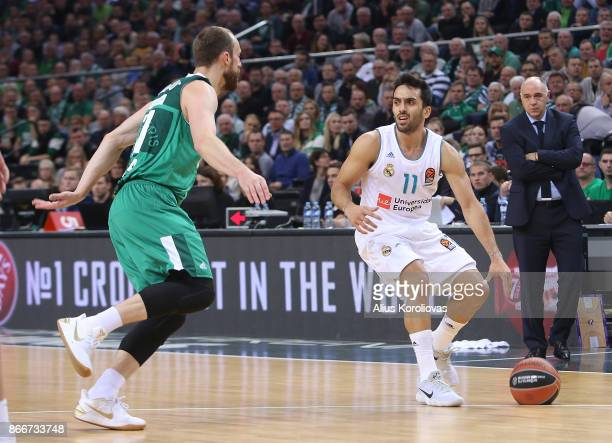 Facundo Campazzo #11 of Real Madrid competes with Arturas Milaknis #21 of Zalgiris Kaunas in action during the 2017/2018 Turkish Airlines EuroLeague...