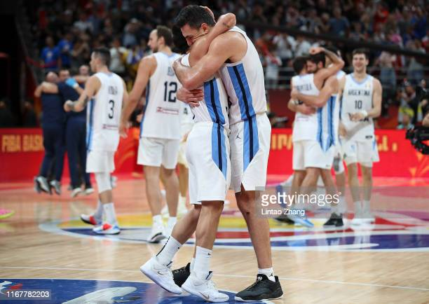 Facundo Campazzo and Luis Scola of Argentina celebrate after their team's win against France during the semi-finals of 2019 FIBA World Cup match...
