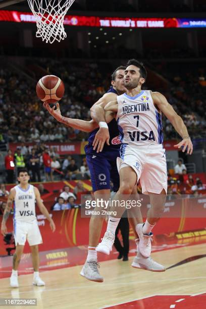 Facundo Campazzo of Argentina drives against Nemanja Bjelica of Serbia during FIBA World Cup 2019 Quarter-finals match between Argentina and Serbia...
