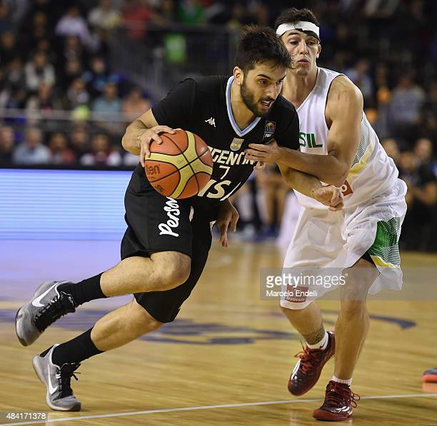 Facundo Campazzo of Argentina drives against Ricardo Fischer of Brazil during a match between Argentina and Brazil as part of Four Nations...