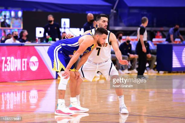 Facundo Campazzo of the Denver Nuggets plays defense on Stephen Curry of the Golden State Warriors during the game on April 12, 2021 at Chase Center...