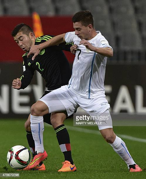 Facundo Castro of Uruguay fights for the ball with Kevin Gutierrez of Mexico during the FIFA Under20 World Cup football match between Mexico and...