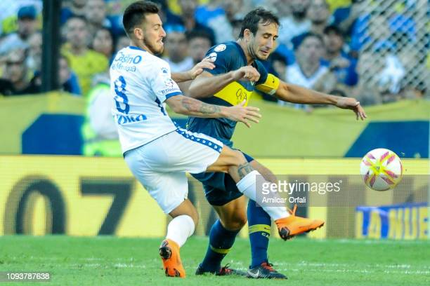 Facundo Cobos of Godoy Cruz fights for the ball with Carlos Izquierdoz of Boca Juniors during a match between Boca Juniors and Godoy Cruz as part of...