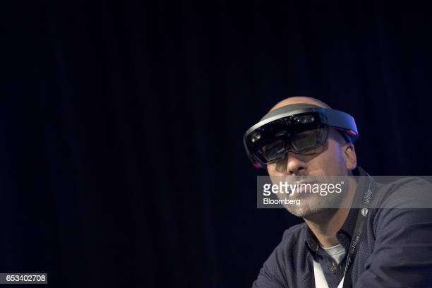 Facundo Diaz cofounder and chief executive officer of Vrtify Inc wears a pair of Microsoft Corp HoloLens glasses as he speaks at the 2017 South By...
