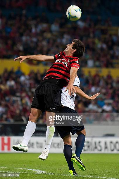 Facundo Erpen of Atlas struggles for the ball with Diego Ordaz of Atlante during the match as part of the Clausura 2013 Liga MX at Estadio Jalisco on...