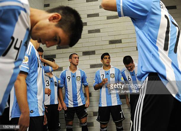 Facundo Ferreyra and Matias Laba of Argentina stand with their teammates in the tunnel prior to the FIFA U20 World Cup Colombia 2011 round of 16...
