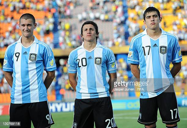 Facundo Ferreyra Carlos Luque and Rodrigo Battaglia of Argentina listen to their countries national anthems during the FIFA U20 World Cup Colombia...