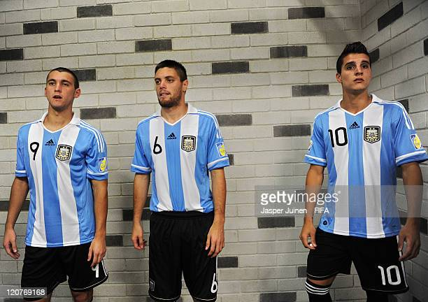 Facundo Ferreyra Leonel Galeano and Erik Lamela of Argentina stand in the tunnel prior to the FIFA U20 World Cup Colombia 2011 round of 16 match...
