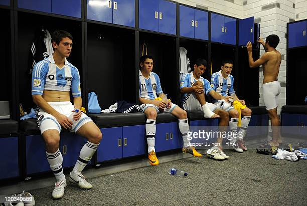 Facundo Ferreyra of Argentina sits with his teammates inside the dressing room after the FIFA U20 World Cup Colombia 2011 group F match between...