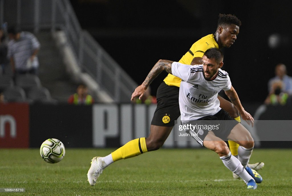 Facundo Ferreyra #19 of Benfica battles for the ball against Dan-Axel Zagadou #2 of Borussia Dortmund in the second half during the 2018 International Champions Cup match at Heinz Field on July 25, 2018 in Pittsburgh, Pennsylvania.