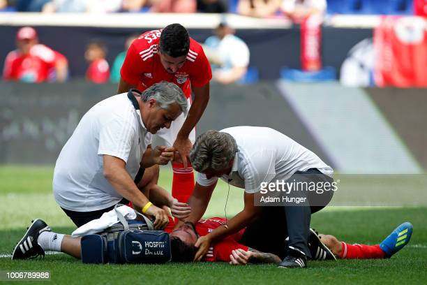 Facundo Ferreyra of Benfica is checked on by team trainers after an injury against Juventus during the International Champions Cup 2018 match between...