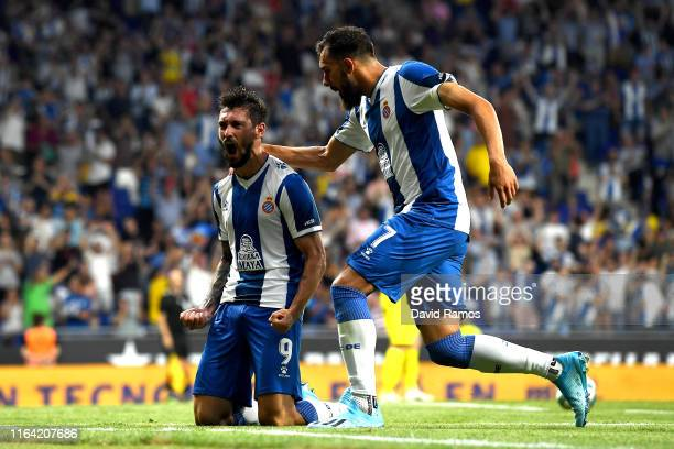 Facundo Ferreyra of RCD Espanyol celebrates with his team mate Borja Iglesias after scoring his team's first goal during the UEFA Europa League...