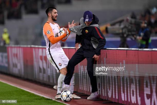 Facundo Ferreyra of Shakhtar Donetsk hits the ball boy pushing him beyond the billboards during the UEFA Champions League Round of 16 match between...