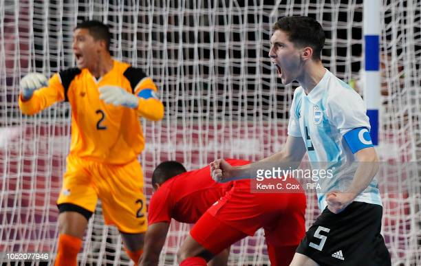 Facundo Gassman of Argentina celebrates scoring the first goal against Panama in the Men's Futsal Group A match between Panama and Argentina during...